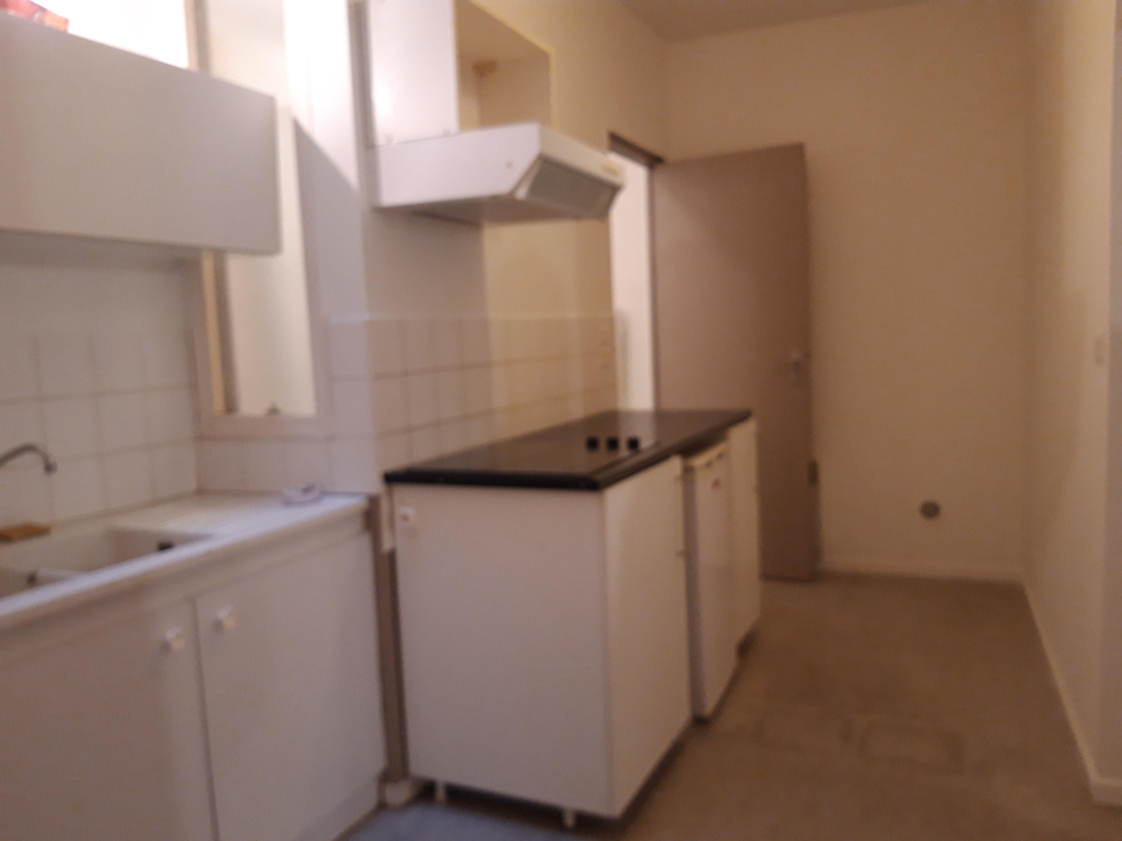 Appartement T2 à louer en RDC d'un immeuble du centre historique de Figeac